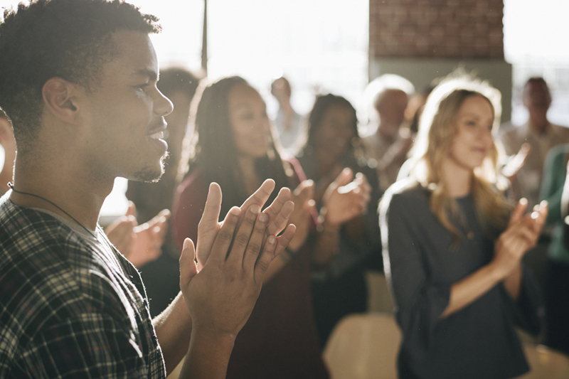 Diverse people clapping after a session