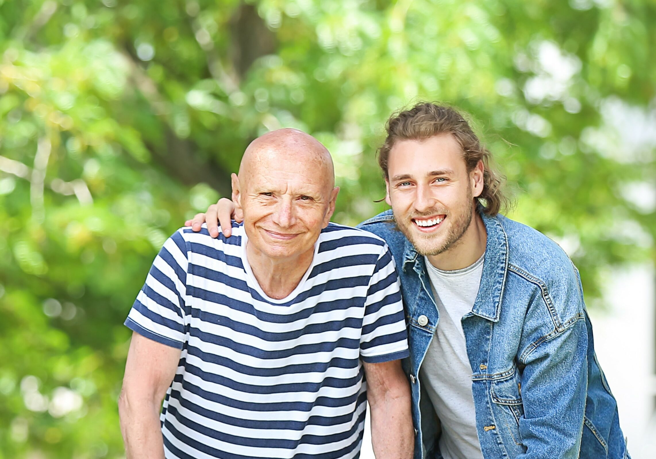 Elderly man with his son in park
